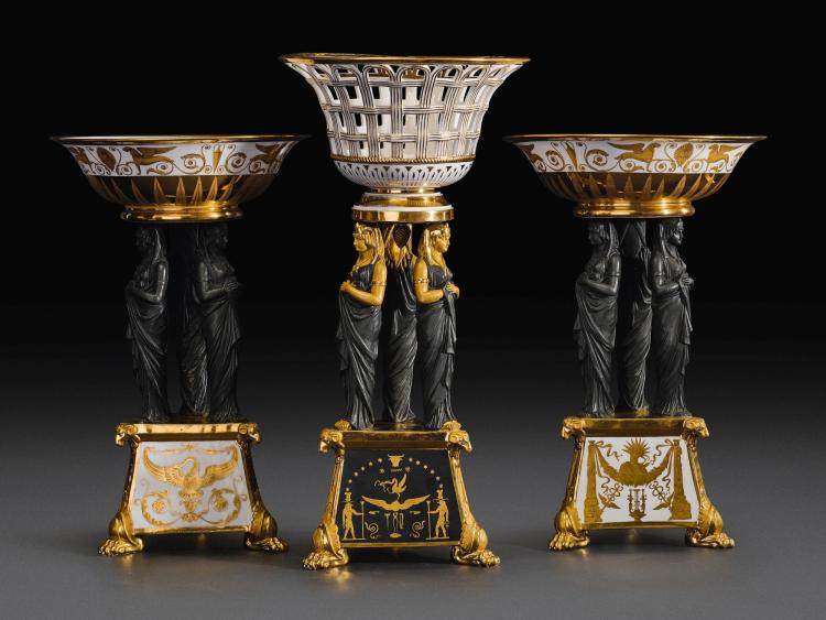 A GARNITURE OF THREE PARIS PORCELAIN RETOUR D'EGYPTE TAZZE, ATTRIBUTED TO THE DAGOTY FACTORY, CIRCA 1805-10 |