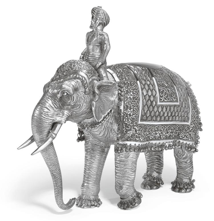 AN INDIAN SILVER MODEL OF A CEREMONIAL ELEPHANT AND RIDER, UNMARKED, POSSIBLY BHUJ, LATE-19TH CENTURY |