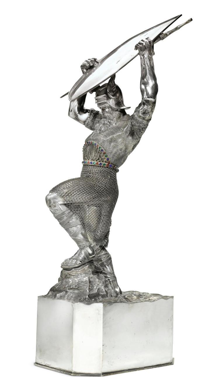 A GERMAN SILVER AND JEWEL-SET FIGURE OF 'HAGEN THROWING TREASURES OF NIBELUNGEN INTO THE RHINE' , GEORG ROTH, HANAU, CIRCA 1900 |