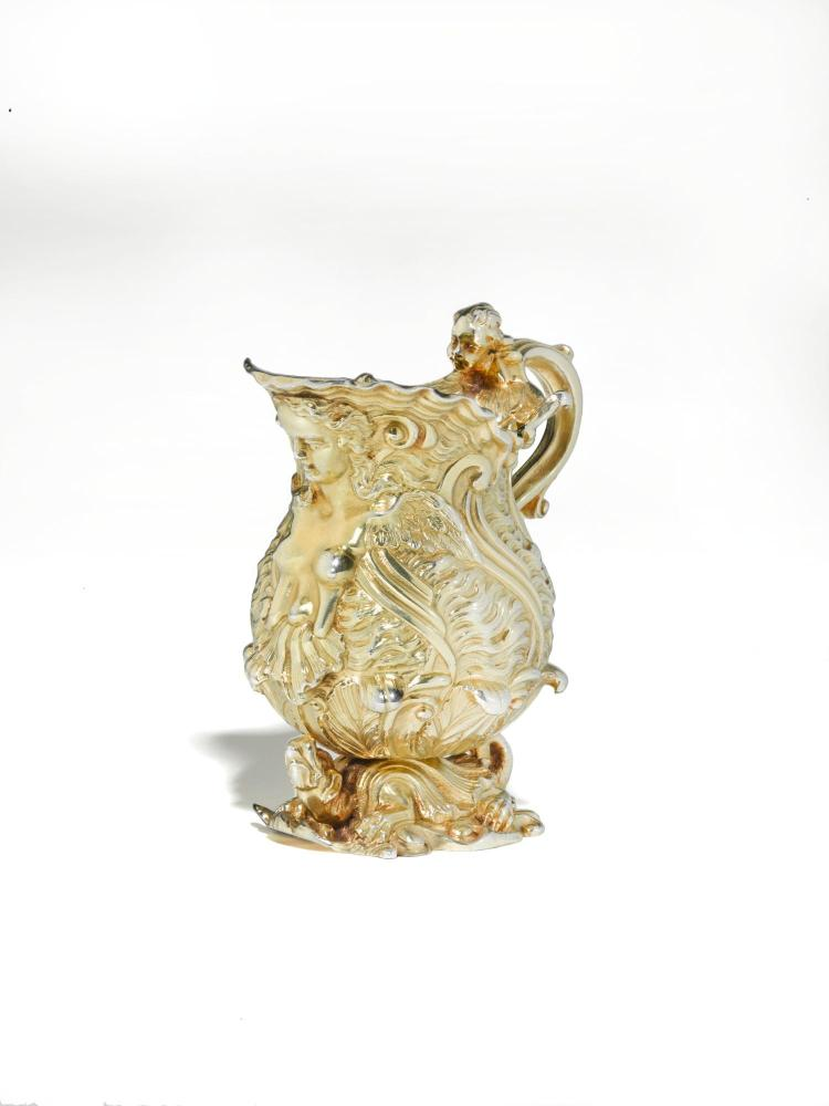 A GEORGE II SILVER-GILT CREAM JUG, UNMARKED, RECORDED IN GEORGE WICKES'S GENTLEMAN'S LEDGER ON 25 FEBRUARY 1742  