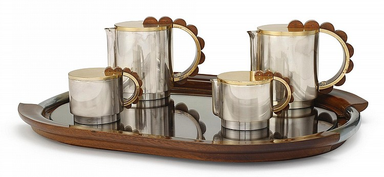 A FRENCH PARCEL-GILT SILVER FOUR-PIECE TEA AND COFFEE SET WITH SIMILAR TRAY, PUIFORCAT, PARIS, CIRCA 1945-50 |