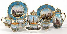 A KPM BLUE-GROUND TOPOGRAHICAL PART TEA SERVICE<BR>CIRCA 1830 |