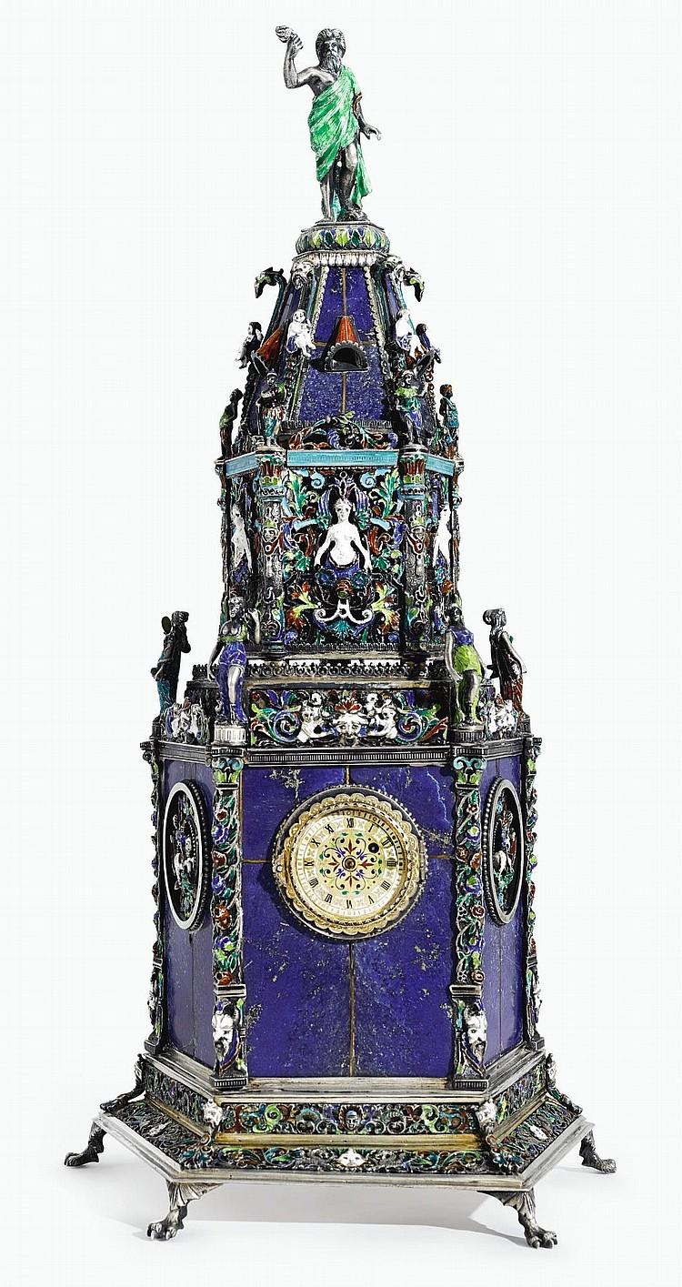 AN AUSTRIAN PARCEL-GILTSILVER, ENAMEL AND LAPIS LAZULI PENTAGONAL TOWER CLOCK, HERMANN BOEHM, VIENNA, CIRCA 1890 |