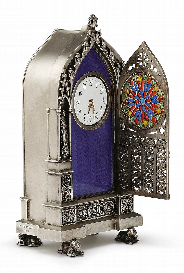 A SILVER-GILT AND PLIQUE-À-JOUR ENAMEL GOTHIC-STYLE SMALL CLOCK, SIGNED G. BRICTEUX, DATED 1917 |