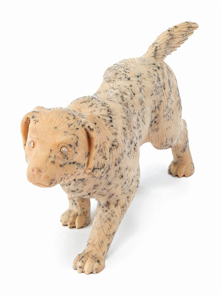 A RUSSIAN CARVED HARDSTONE FIGURE OF A DOG, CIRCA 1900 |