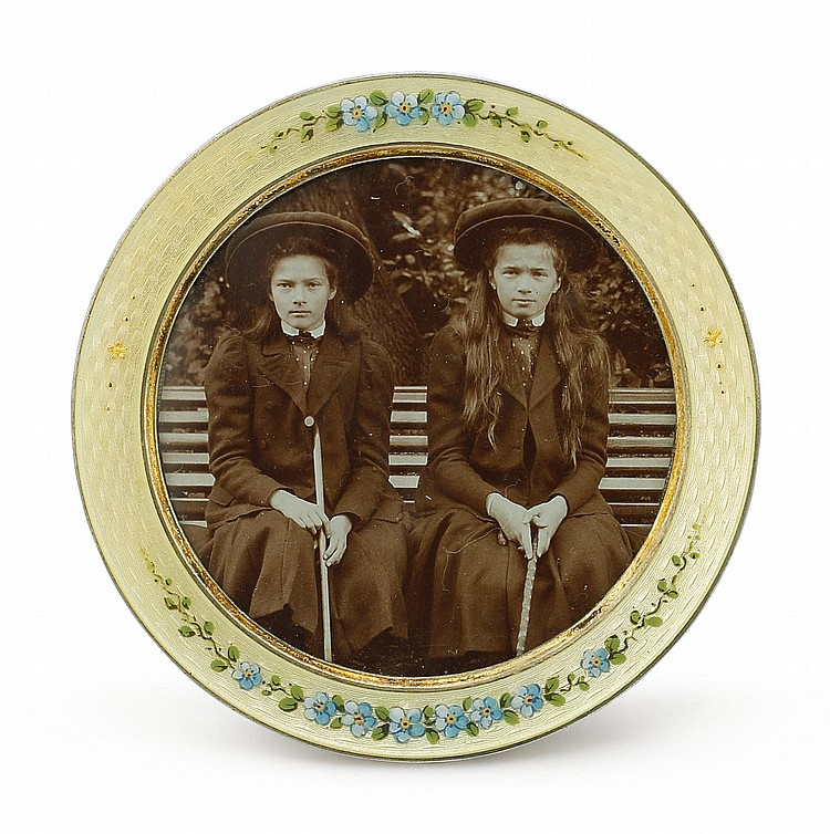 A SILVER-GILT AND GUILLOCHÉ ENAMEL PHOTOGRAPH FRAME WITH PHOTO OF GRAND DUCHESSES OLGA AND TATIANA, CIRCA 1910 |