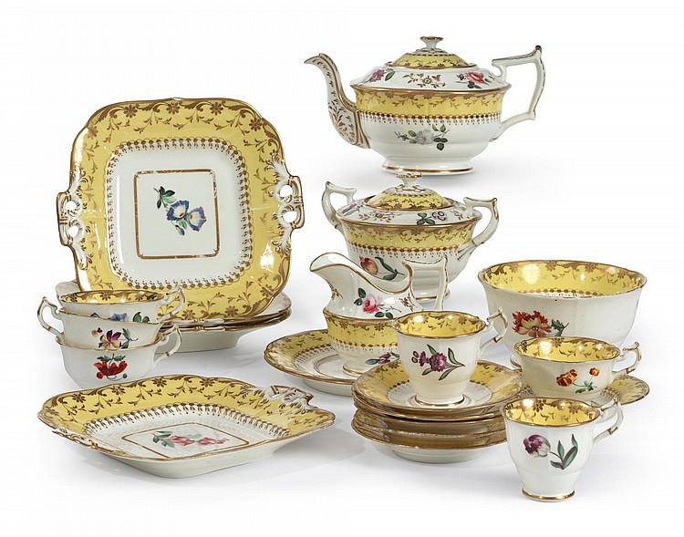 AN ENGLISH PORCELAIN YELLOW-BORDERED PART DESSERT AND TEA SERVICE<BR>CIRCA 1840 |