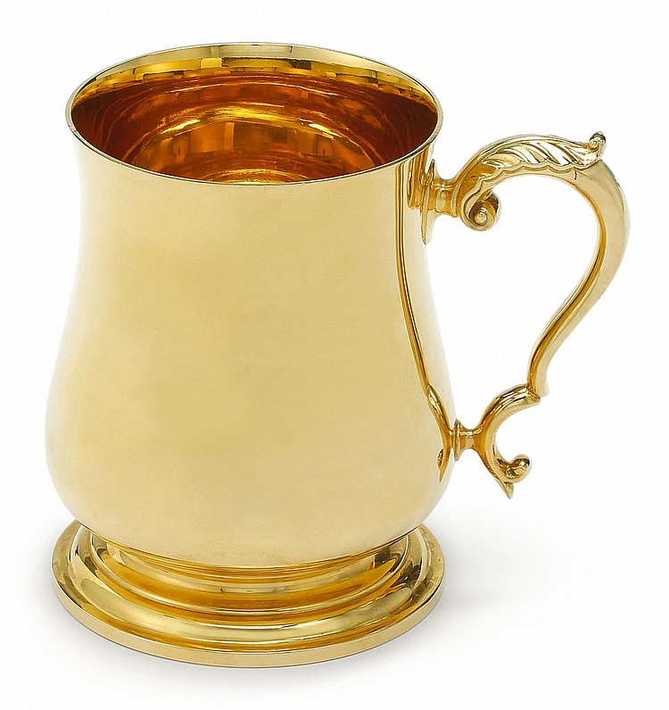 GOLD: AN ENGLISH 18 KARAT GOLD MUG, RETAILED BY BULGARI, 1993 |