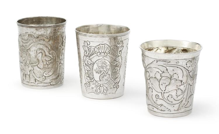 THREE RUSSIAN SILVER EMBOSSED BEAKERS, MOSCOW, SECOND HALF 18TH CENTURY |