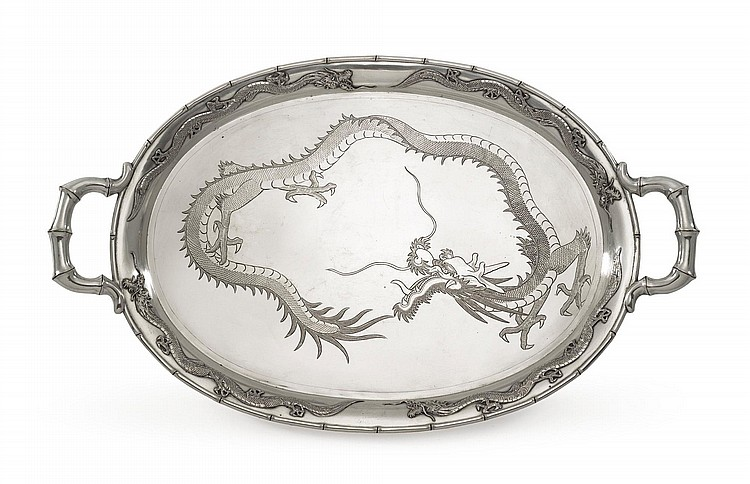 A CHINESE EXPORT SILVER TWO-HANDLED TRAY, TUCK CHANG & CO., SHANGHAI, CIRCA 1900 |