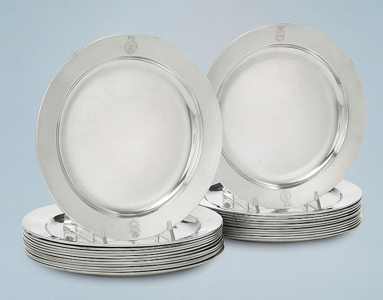 A SET OF TWENTY-FOUR GEORGE III SILVER DINNER PLATES ENGRAVED WITH THE ROYAL BADGE, HENRY CHAWNER, LONDON, 1794 |