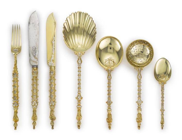 A VICTORIAN PARCEL-GILT RENAISSANCE STYLE DESSERT FLATWARE SERVICE, JOHN ALDWINCKLE & JAMES SLATER, LONDON, 1883 |
