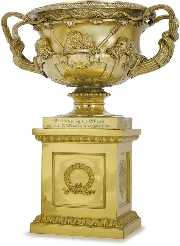 A REGENCY SILVER-GILT PRESENTATION WARWICK VASE ON ORIGINAL GILT-METAL ARMORIAL PEDESTAL, PAUL STORR, LONDON, 1814 |