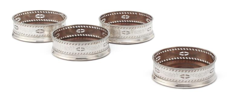 A SET OF FOUR GEORGE III SILVER WINE COASTERS, HESTER BATEMAN, LONDON, 1788 |