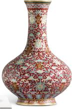 A RUBY-GROUND FAMILLE-ROSE BOTTLE VASE<BR> QING DYNASTY, 19TH CENTURY |
