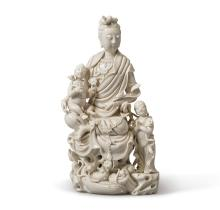 A 'DEHUA' 'GUANYIN AND CHILD' GROUP<BR> QING DYNASTY, 18TH / 19TH CENTURY |