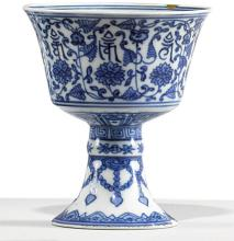 A SMALL BLUE AND WHITE STEMCUP WITH 'LANÇA' CHARACTERS<BR> QIANLONG SEAL MARK AND PERIOD |