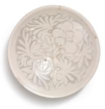 A CARVED 'CIZHOU' 'PEONY' BOWL<BR>LATE NORTHERN SONG DYNASTY, 12TH CENTURY |