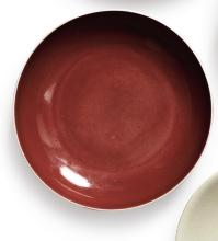 A COPPER-RED-GLAZED DISH<BR> QIANLONG SEAL MARK AND PERIOD |