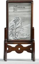 A GRISAILLE-PAINTED TABLE SCREEN<BR> 20TH CENTURY, SIGNED HE XUREN (1882-1940) |