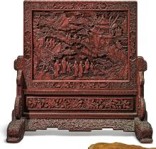 A CINNABAR LACQUERED CARVED WOOD TABLE SCREEN<BR> QING DYNASTY, 19TH CENTURY |