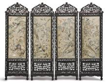 AN EMBROIDERED SILK AND CARVED WOOD FOUR-PANEL SCREEN<BR> LATE QING DYNASTY |
