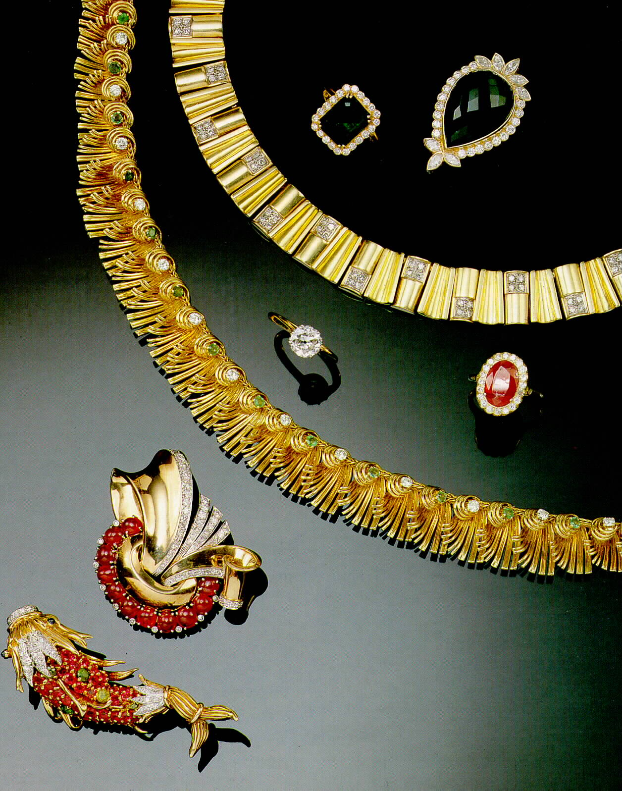 DESC-A RUBY AND DIAMOND CLIP BY TRABERT & HOEFFER, MAUBOUSSIN,