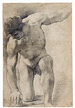 GIOVANNI FRANCESCO BARBIERI, CALLED IL GUERCINO | A male nude kneeling, his right hand resting on a stone