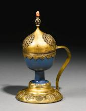 A CHINESE PORCELAIN CUP WITH OTTOMANTOMBAK MOUNTS SET WITH ACORAL FINIAL, CHINA AND TURKEY, 18TH CENTURY |