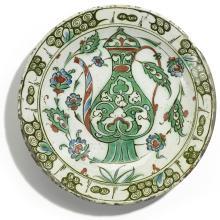 AN IZNIK POLYCHROME POTTERY DISH WITH EWER, TURKEY, EARLY 17TH CENTURY |