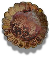 A KASHAN RED LUSTRE POTTERY DISH, PERSIA, CIRCA 1200 AD |