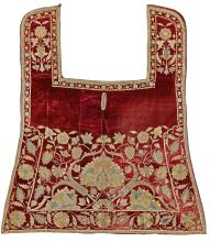 AN OTTOMAN METAL-THREAD EMBROIDERED RED-GROUND SADDLE COVER, TURKEY, LATE 17TH/EARLY 18TH CENTURY |