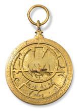 A RARE UMAYYAD BRASS ASTROLABE, SIGNED BY MUHAMMAD IBN AL-SAFFAR, SPAIN, CORDOBA, DATED IN WESTERN ABJAD 411 AH/1020 AD, WITH LATER OTTOMAN TURKISH RETE, 16TH/17TH CENTURY |