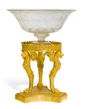 AN EMPIRE STYLE GILT-BRONZE TAZZA STAND NOW MOUNTED WITH A GLASS FOOTED BOWL |