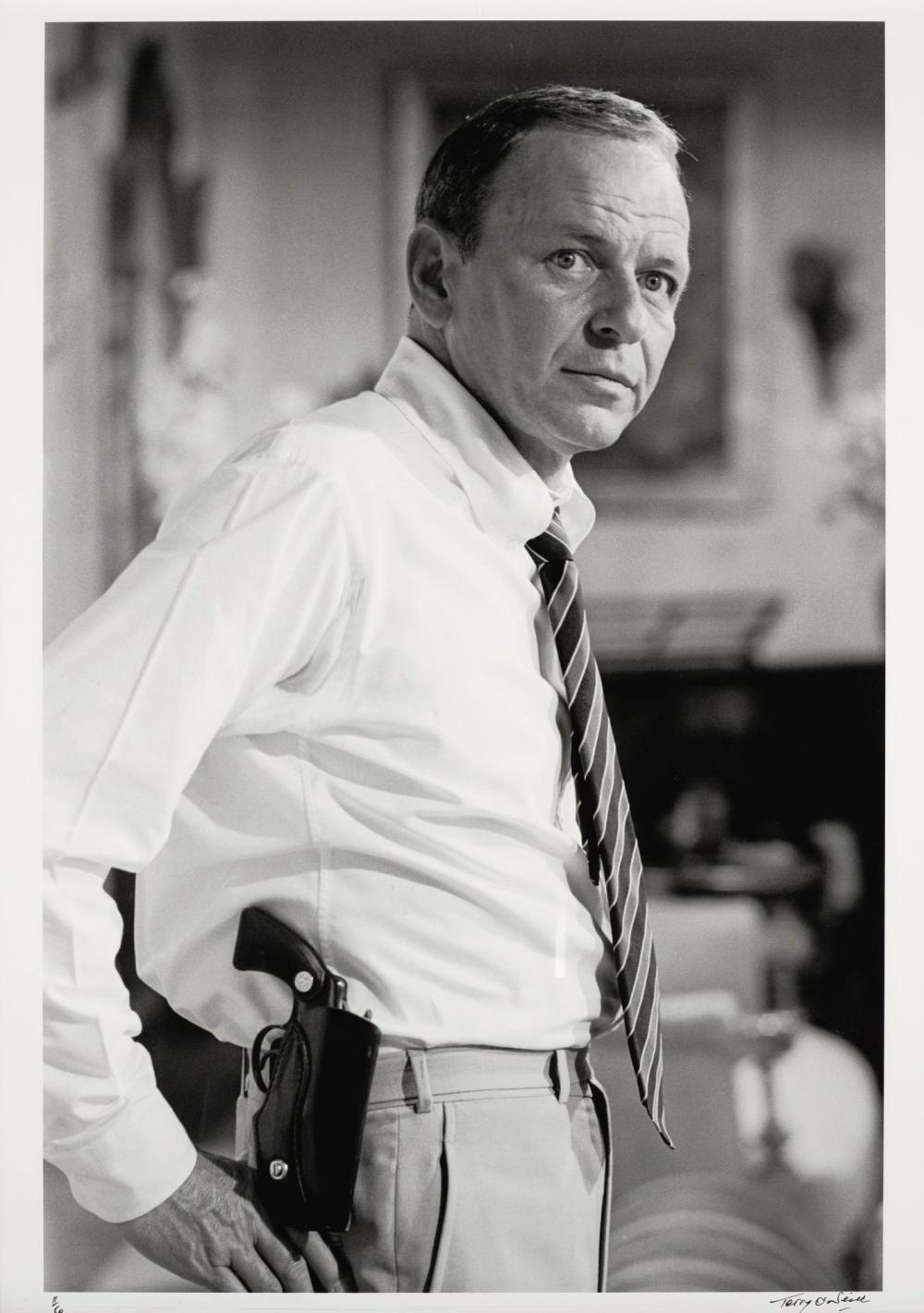 TERRY O'NEILL | Frank Sinatra with Gun, Miami Beach, 1968