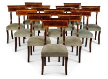 A SET OF TWELVE REGENCY STYLE BRASS MOUNTED MAHOGANY DINING CHAIRS  