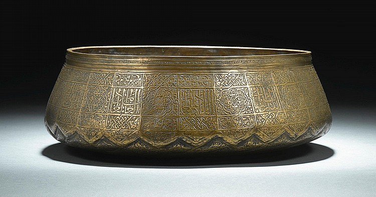 A RARE MAMLUK ENGRAVED-BRASS BASIN FROM THE REIGN OF SULTAN QAYTBAY (1468-1496), EGYPT, LATE 15TH CENTURY |