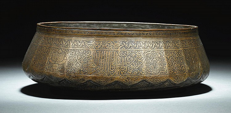 A RARE MAMLUK ENGRAVED BRASS BASIN FROM THE REIGN OF SULTAN QAYTBAY (1468-96), EGYPT, LATE 15TH CENTURY<BR /> |