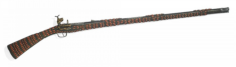 A RARE OTTOMAN FULLY CORAL-SET MIQUELET FLINTLOCK RIFLE, TURKEY OR OTTOMAN PROVINCES, DATED 1106 AH/1694 AD |