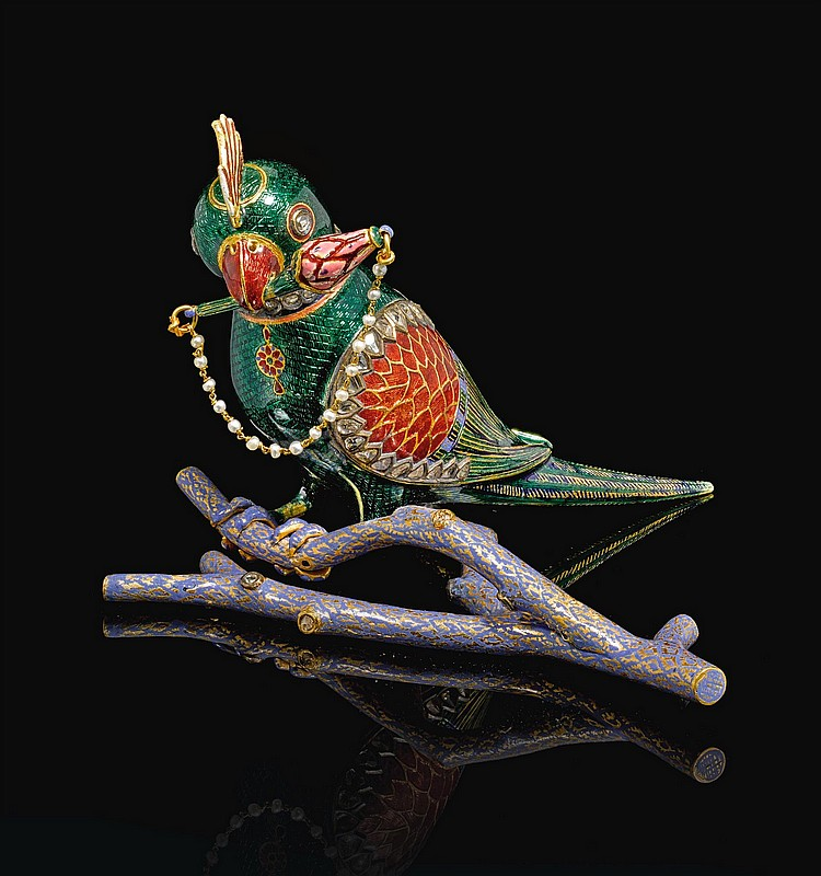 A GOLD, POLYCHROME ENAMELLED AND GEM-SET PARROT-FORM FLASK (CHUSKI) ON A BRANCH, NORTH INDIA, 19TH CENTURY |
