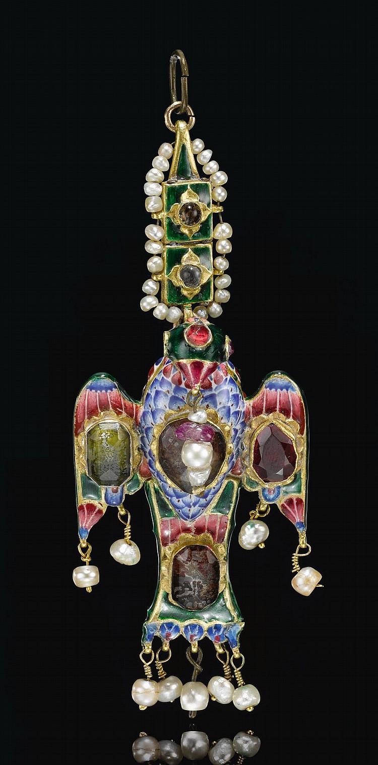A QAJAR GOLDANDENAMELLED EAGLE-FORM PENDANT, PERSIA, 19TH CENTURY |