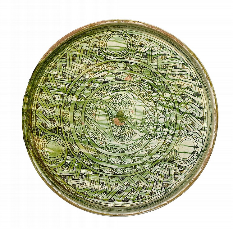 A LARGE SPLASHED AND INCISED POTTERY DISH, PERSIA OR CENTRAL ASIA, 11TH/12TH CENTURY |