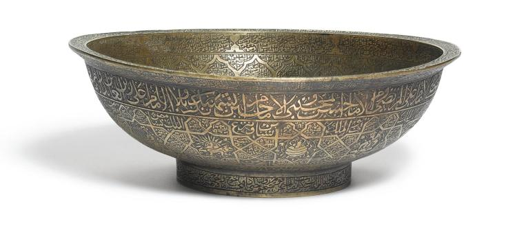 A QAJAR INSCRIBED BRASS MAGIC BOWL, PERSIA, 19TH CENTURY |