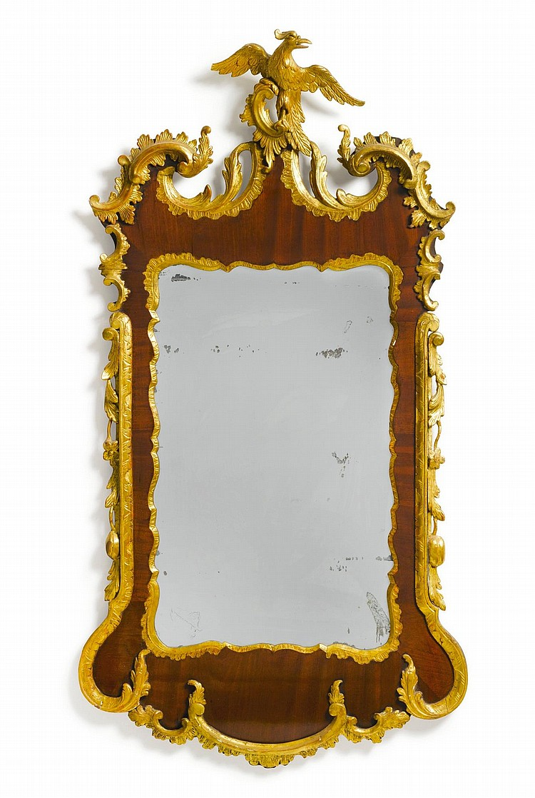 GEORGE II PARCEL-GILT AND MAHOGANY LOOKING GLASS, ENGLAND, CIRCA 1755 |
