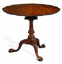 THE BUNTING FAMILY CHIPPENDALE CARVED AND FIGURED MAHOGANY PIE CRUST TILT-TOP TEA TABLE, PHILADELPHIA, CIRCA 1770 |