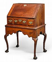 QUEEN ANNE CARVED AND FIGURED WALNUT SLANT-FRONT DESK-ON-FRAME, PENNSYLVANIA, CIRCA 1740 |