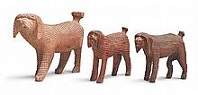 THREE CARVED WOODEN DOGS, ATTRIBUTED TO AARON MOUNTZ, CUMBERLAND COUNTY, PENNSYLVANIA, 19TH CENTURY | Three Carved Wooden Dogs