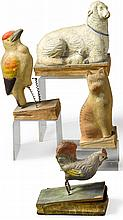 FOURPIPSQUEAKS IN THE FORM OF ASHEEP WITH LAMB,A WOODPECKER, A ROOSTER AND A SEATED CAT, GERMAN, 19TH CENTURY | FourPipsqueaks in the Form of aSheep with Lamb,a Woodpecker, a Rooster and a Seated Cat