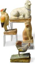 FOUR PIPSQUEAKS IN THE FORM OF A SHEEP WITH LAMB, A WOODPECKER, A ROOSTER AND A SEATED CAT, GERMAN, 19TH CENTURY | Four Pipsqueaks in the Form of a Sheep with Lamb, a Woodpecker, a Rooster and a Seated Cat