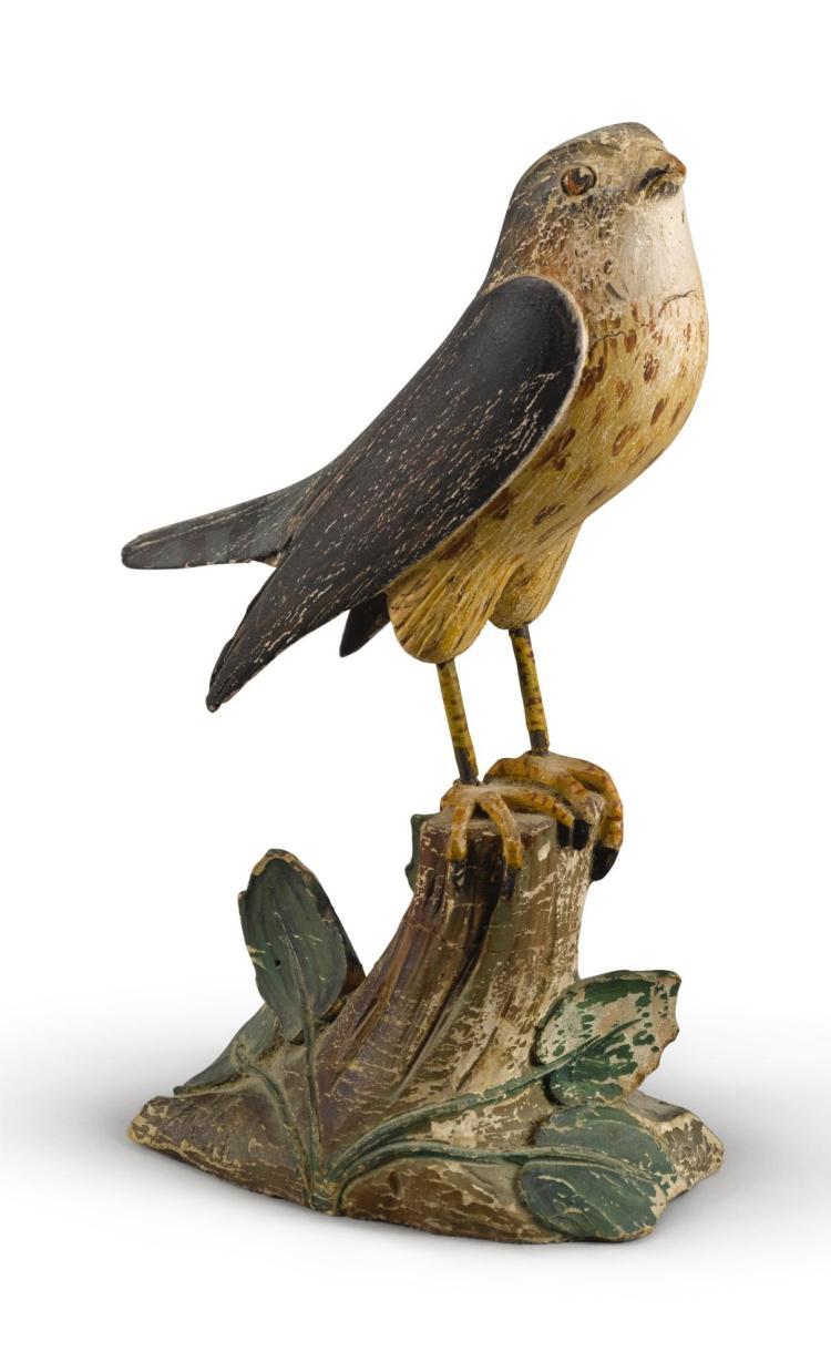 CARVED WOOD PIGEON HAWK STANDING ON A TREE STUMP, EARLY 20TH CENTURY | Carved Wood Pigeon Hawk Standing on a Tree Stump